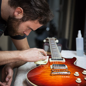 Luthier Polishing Electric Guitar
