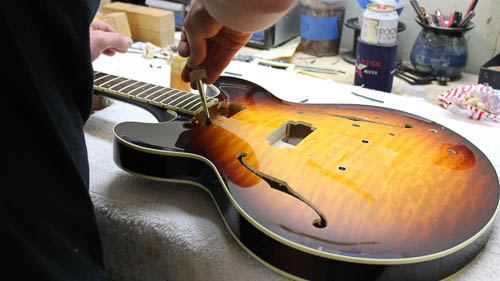 Luthier Setting Up Electric Guitar